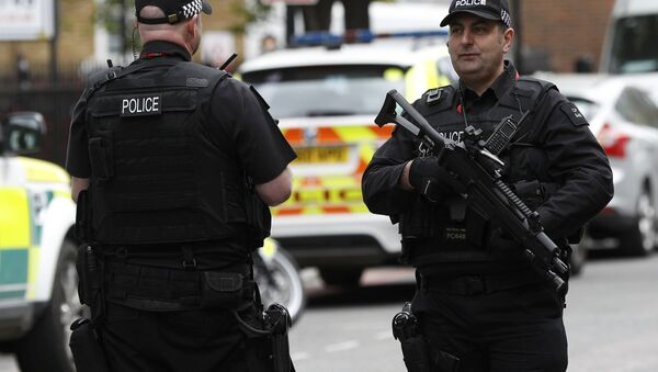Armed police officers patrol the streets near Southwark Cathedral ahead of the funeral of PC Keith Palmer, who was killed in the recent Westminster attack, in central London, Britain April 10, 2017. - Sputnik International