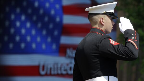 An officer of the US Marine Corps Color Guard stands at attention during the flag raising ceremony at the official opening of National Day USA at the Expo 2015 world's fair in Rho, near Milan, Italy, 4 July 2015.  - Sputnik International