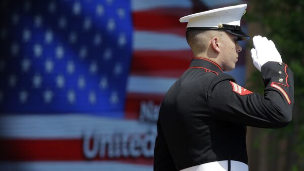 An officer of the US Marine Corps Color Guard stands at attention during the flag raising ceremony at the official opening of the National Day USA, at the Expo 2015 world's fair in Rho, near Milan, Italy, Saturday, July 4, 2015.  - Sputnik International
