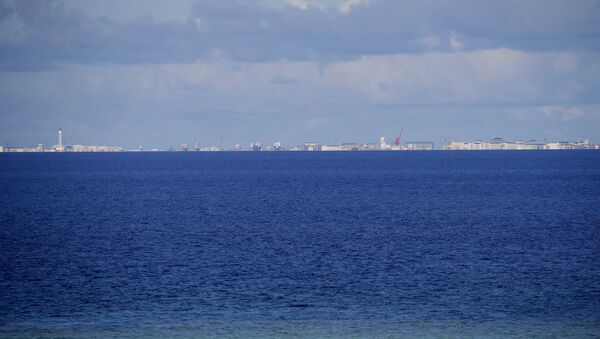 Chinese structures and buildings on the man-made Subi Reef at the Spratlys group of islands are seen 18 kilometers (11 miles) away from the Philippine-claimed Thitu Island off the disputed South China Sea - Sputnik International