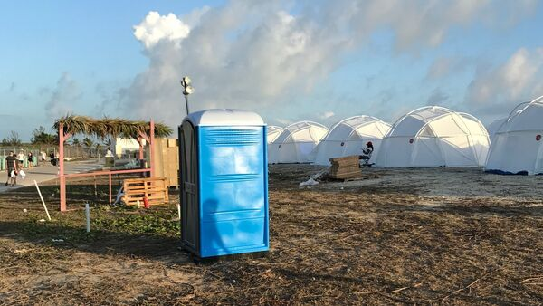 This photo provided by Jake Strang shows tents and a portable toilet set up for attendees for the Fyre Festival, Friday, April 28, 2017 in the Exuma islands, Bahamas. Organizers of the much-hyped music festival in the Bahamas canceled the weekend event at the last minute Friday after many people had already arrived and spent thousands of dollars on tickets and travel. - Sputnik International
