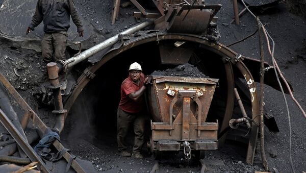 (File) In this Monday, Aug. 18, 2014 photo, an Iranian coal miner pushes a metal cart loaded with coal at a mine near the city of Zirab 212 kilometers (132 miles) northeast of the capital Tehran, on a mountain in Mazandaran province, Iran - Sputnik International