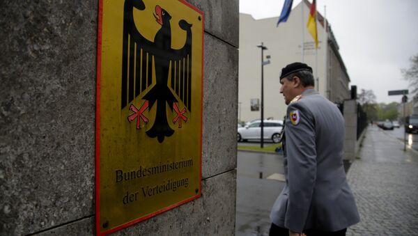 A German forces Bundeswehr officer enters the German Defense Ministry prior to a meeting between Defense Minister Ursula von der Leyen and about 100 top officers in Berlin, Thursday, May 4, 2017. - Sputnik International
