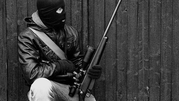 A man holding a rifle - Sputnik International