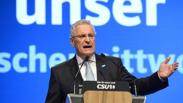 Bavaria's Interior Minister Joachim Herrmann of the German Christian Social Union (CSU) speaks at the party's traditional Ash Wednesday rally in Passau, southern Germany, on March 1, 2017 - Sputnik International