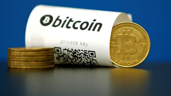 A Bitcoin (virtual currency) paper wallet with QR codes and a coin are seen in an illustration picture taken at La Maison du Bitcoin in Paris, France May 27, 2015 - Sputnik International