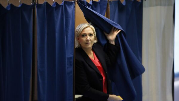 French far-right presidential candidate, Marine Le Pen exits a voting booth before casting her ballot in Henin Beaumont, France - Sputnik International