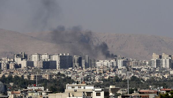 This Friday, August 23, 2013 file photo, black columns of smoke from heavy shelling in Barzeh, a suburb of Damascus, Syria. - Sputnik International