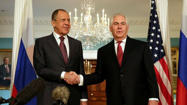 U.S. Secretary of State Rex Tillerson (R) shakes hands with Russian Foreign Minister Sergey Lavrov before their meeting at the State Department in Washington, U.S., May 10, 2017. - Sputnik International