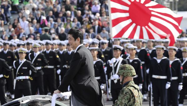 Japanese Prime Minister Shinzo Abe, center standing, reviews members of Japan Self-Defense Forces (SDF) during the Self-Defense Forces Day at Asaka Base, north of Tokyo, Sunday, Oct. 23, 2016. - Sputnik International