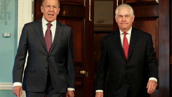 U.S. Secretary of State Rex Tillerson (R) walks with Russian Foreign Minister Sergey Lavrov before their meeting at the State Department in Washington, U.S - Sputnik International