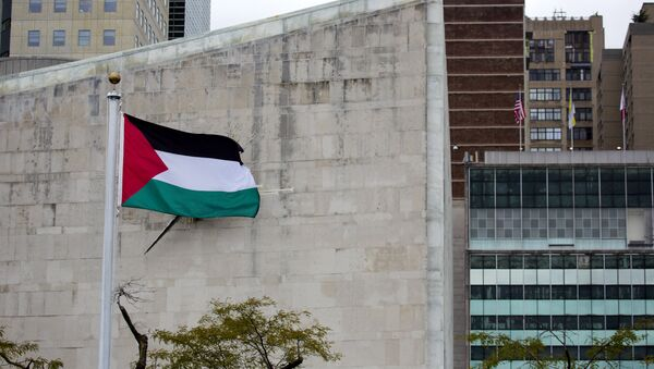 The Palestinian flag flies in the wind after a Rose Garden ceremony at the United Nations headquarters - Sputnik International