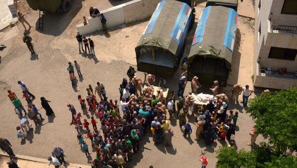 Russian humanitarian aid is distributed at Ras al-Bassit refugee camp - Sputnik International