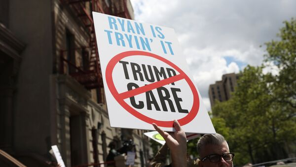 Demonstrators and healthcare activists rally before the visit of Speaker of the U.S. House of Representatives Paul Ryan at the Success Academy 1 charter school in Harlem, New York, U.S., May 9, 2017 - Sputnik International