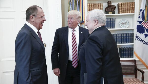A handout photo made available by the Russian Foreign Ministry on May 10, 2017 shows US President Donald J. Trump (C) speaking with Russian Foreign Minister Sergei Lavrov (L) and Russian Ambassador to the U.S. Sergei Kislyak during a meeting at the White House in Washington, DC - Sputnik International
