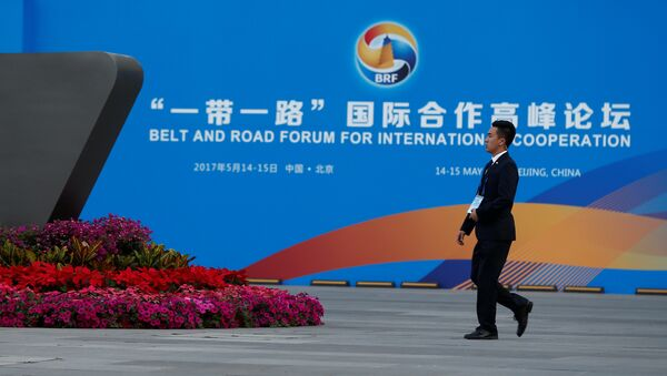 A man walks past the China National Convention Center, a venue of the upcoming Belt and Road Forum in Beijing, China, May 12, 2017 - Sputnik International