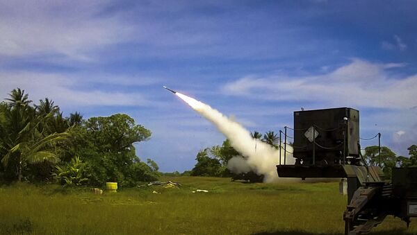 A Patriot Advanced Capability 3 (PAC-3) interceptor is launched from Omelek Island during MDA's historic integrated flight test on Oct. 24, 2012. - Sputnik International