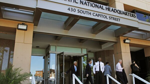 People stand outside the Democratic National Committee (DNC) headquarters in Washington, Tuesday, June 14, 2016 - Sputnik International