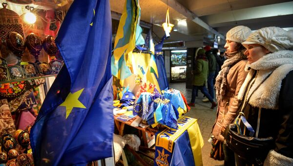Girls look on at souvenirs in the underpass on Independence Square, Kiev. File photo - Sputnik International