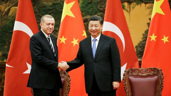 Turkish President Recep Tayyip Erdogan and Chinese President Xi Jinping attend a signing ceremony ahead of the Belt and Road Forum in Beijing, China May 13, 2017 - Sputnik International