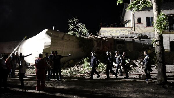 Rescuers and others stand near the site of a fatal train derailment close to the northern city of Thessaloniki, Greece on Sunday, May 14, 2017. - Sputnik International