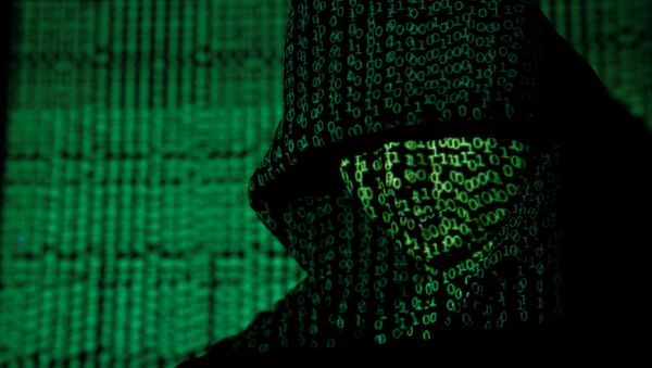 A projection of cyber code on a hooded man is pictured in this illustration picture taken on May 13, 2017 - Sputnik International