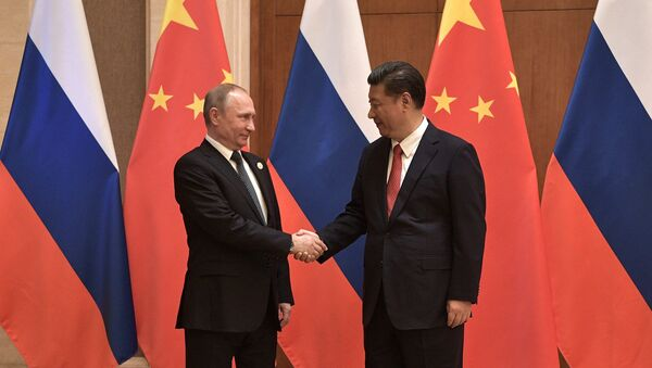 President Vladimir Putin and President of China Xi Jinping, right, during the Russia-China talks at the One Belt, One Road international forum - Sputnik International