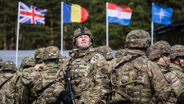 US soldiers are pictured prior the beginning of the official welcoming ceremony of NATO troops in Orzysz, Poland, on April 13, 2017. - Sputnik International