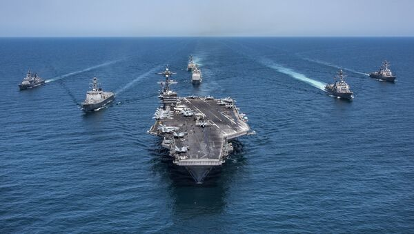 In this image released by the U.S. Navy, the aircraft carrier USS Carl Vinson, flanked by South Korean destroyers, from left, Yang Manchun and Sejong the Great, and the U.S.Navy's Wayne E. Meyer and USS Michael Murphy, transit the western Pacific Ocean Wednesday, May 3, 2017. - Sputnik International