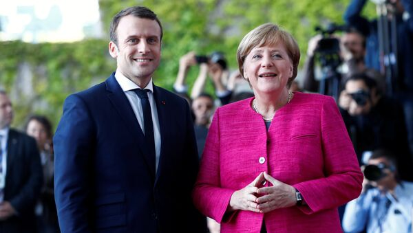 German Chancellor Angela Merkel and French President Emmanuel Macron arrive at a ceremony at the Chancellery in Berlin, Germany, May 15, 2017. - Sputnik International