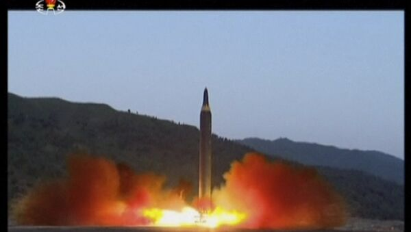 This image made from video of a news bulletin aired by North Korea's KRT on Monday, May 15, 2017, shows what was said to be the launch of the Hwasong-12 missile at an undisclosed location in North Korea.  - Sputnik International