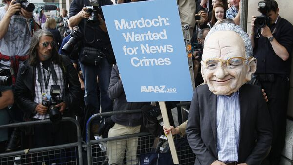 A protester wearing a Rupert Murdoch mask is photographed by media outside parliament in London, Tuesday, July 19, 2011.  - Sputnik International