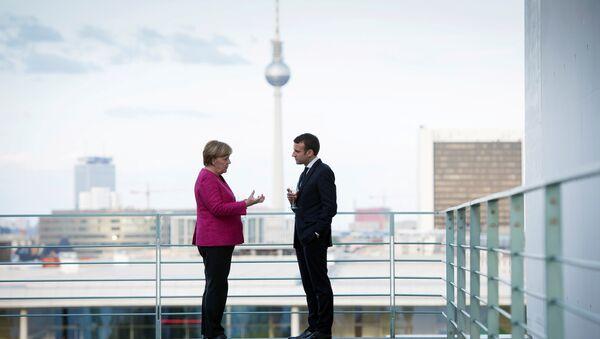 German Chancellor Angela Merkel and French President Emmanuel Macron meet at the Chancellery in Berlin, Germany May 15, 2017 - Sputnik International