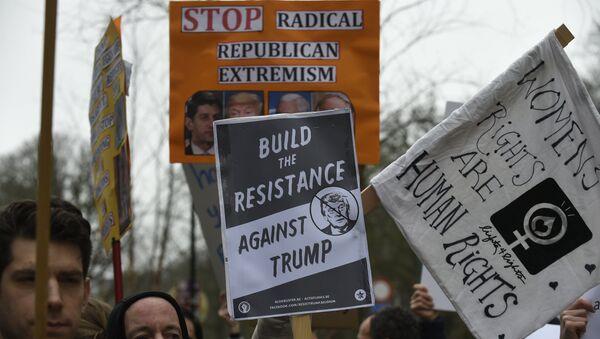 Protesters hold banners during a demonstration in Brussels (File) - Sputnik International
