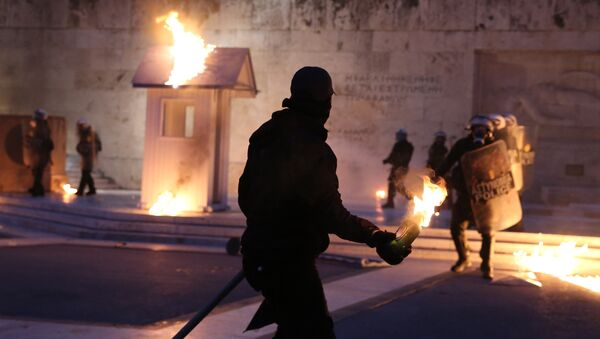 A masked demonstrator prepares to throw a petrol bomb to riot police outside the parliament building as Greek lawmakers vote on the latest round of austerity Greece has agreed with its lenders, in Athens, Greece, May 18, 2017. - Sputnik International