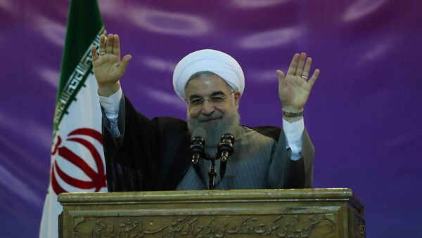 Iran's President Hassan Rouhani gestures during a ceremony celebrating International Workers' Day, in Tehran, Iran, May 1, 2017 - Sputnik International