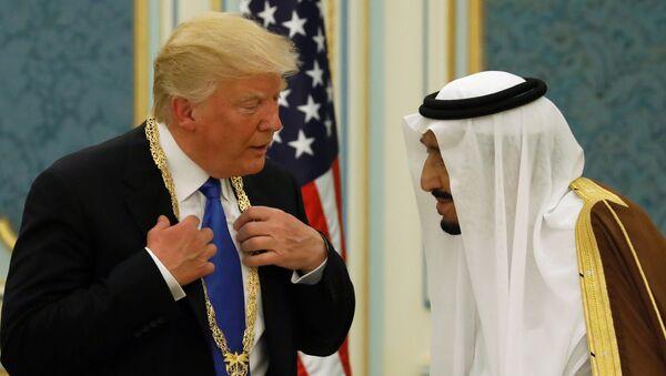 Saudi Arabia's King Salman bin Abdulaziz Al Saud (R) presents U.S. President Donald Trump with the Collar of Abdulaziz Al Saud Medal at the Royal Court in Riyadh, Saudi Arabia May 20, 2017 - Sputnik International