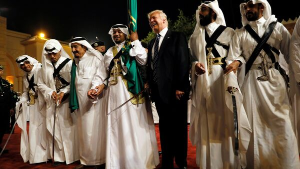 U.S. President Donald Trump dances with a sword as he arrives to a welcome ceremony at Al Murabba Palace in Riyadh, Saudi Arabia May 20, 2017 - Sputnik International