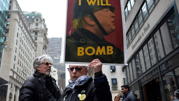 Anti-war protesters shout slogans against US President Donald Trump during a demonstration in front of the Trump Tower in New York on April 7, 2017, to protest the US air strike in Syria - Sputnik International