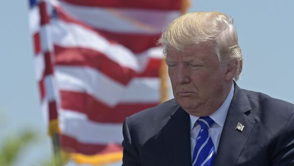 President Donald Trump attends the commencement address at the U.S. Coast Guard Academy in New London, Conn., Wednesday, May 17, 2017 - Sputnik International