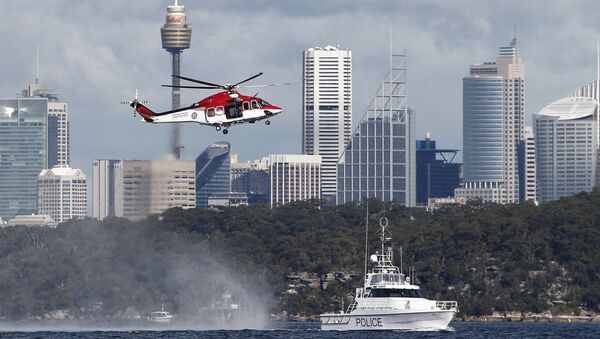 Police and emergency services train with an ambulance helicopter in Sydney Harbour in Sydney, Australia, Wednesday, July 27, 2016 - Sputnik International