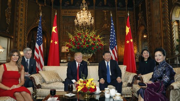 President Donald Trump and Chinese President Xi Jinping, sit with their wives, first lady Melania Trump, left, and Chinese first lady Peng Liyuan, right, before a meeting at Mar-a-Lago, Thursday, April 6, 2017, in Palm Beach, Fla - Sputnik International