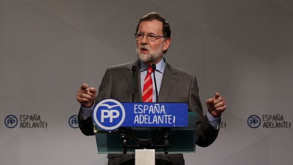 Spain's Prime Minister Mariano Rajoy gestures during a news conference at his ruling People's Party's (PP) headquarters in Madrid, Spain May 22, 2017 - Sputnik International