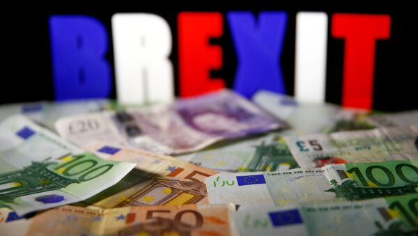 Euro and pound banknotes are seen in front of BREXIT letters in this picture illustration taken April 28, 2017. - Sputnik International