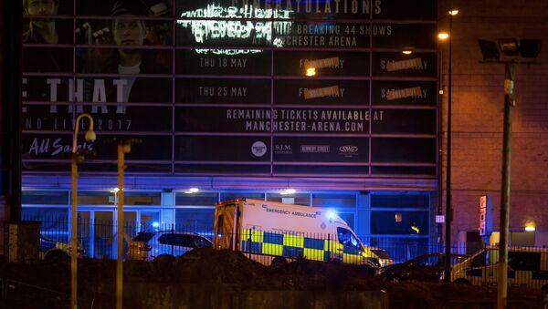A police van and an ambulance are seen outside the Manchester Arena, where U.S. singer Ariana Grande had been performing, in Manchester - Sputnik International
