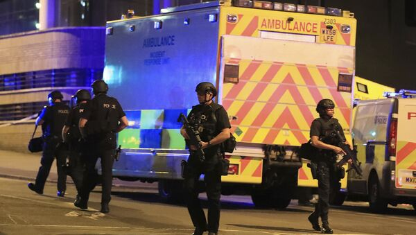 Police stand near an ambulance at Manchester Arena after reports of an explosion at the venue during an Ariana Grande concert on Monday, May 22, 2017. - Sputnik International