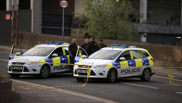 Police officers stand next to their vehicles near the Manchester Arena after a blast at Ariana Grande concert Tuesday May 23, 2017 - Sputnik International