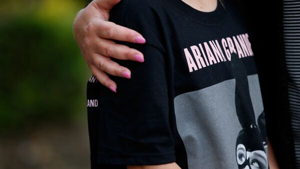 A youngster wearing a t-shirt showing U.S. singer Ariana Grande talks to the media near the Manchester Arena in Manchester, Britain May 23, 2017. - Sputnik International