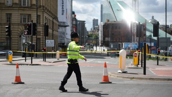 A police officer potrols a cordon near to the Manchester Arena in Manchester, northwest England on May 23, 2017 - Sputnik International