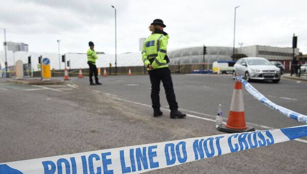A police cordon surrounds Manchester Arena in Manchester, northwest England following the deadly terror attacks on May 23, 2017. - Sputnik International
